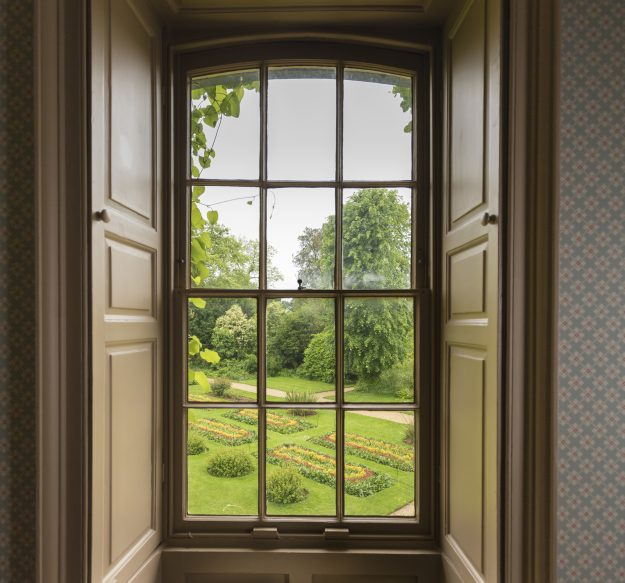 The view of the ornamental bedding in the garden of Down House seen from Charles Darwin's former bedroom.