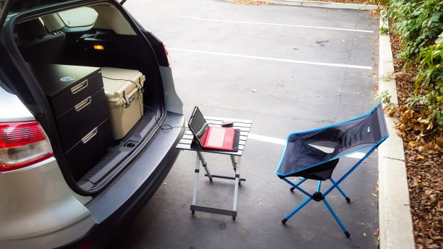 The car also serves as an outdoor office.