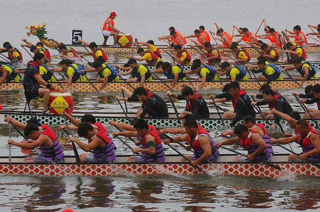 Racers in Jiaxing, Zhejiang Province of China. More than 20 teams joint in the race to celebrate the Dragon Boat Festival.