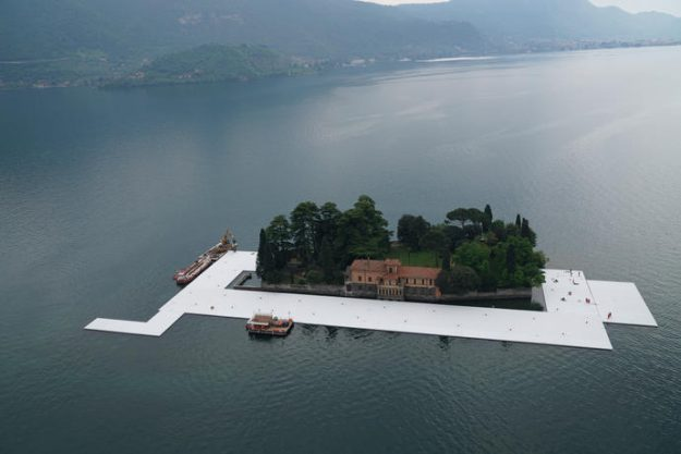 Workers start to encircle the island of San Paolo with the first floating elements, April 2016
