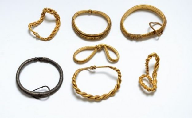 Viking treasure - six gold and one silver bracelet discovered.