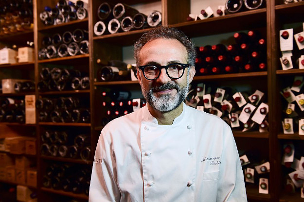 A picture taken on July 7, 2016 shows Italian chef Massimo Bottura posing in his restaurant 'Osteria Francescana' in Modena.