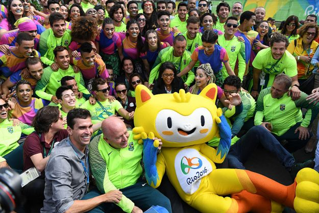 Brazilian team for the 2016 Rio Olympics pose for a group photo in the Athletes Village following their official welcome and flag raising ceremony on July 31.