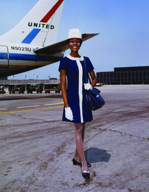 United Air Lines stewardess in uniform by Jean Louis