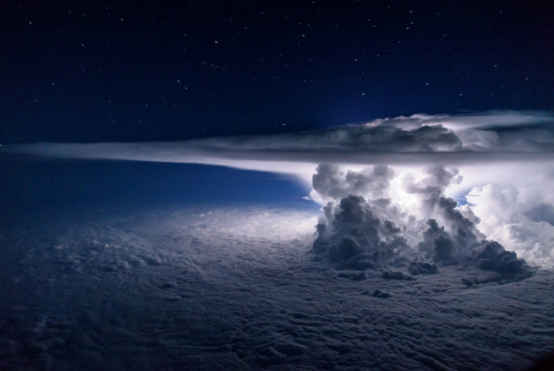 A storm gathers over the Pacific Ocean. Shot at 37,000 feet.