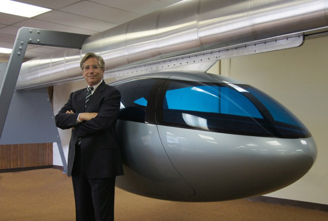 Jerry Sanders, CEO of skyTran, with one of the new transport pods. Image: Miral/skyTran