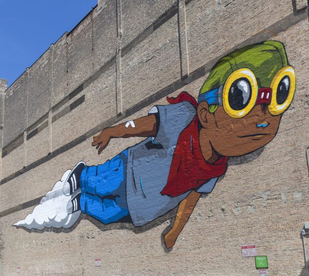 The mural is an example of a more permanent type of American street art.