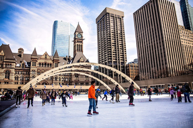 Children ice skating at Nathan Phillips Square in Toronto, Canada.
