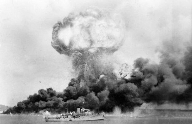 The explosion of an oil storage tank during the Japanese air raid.