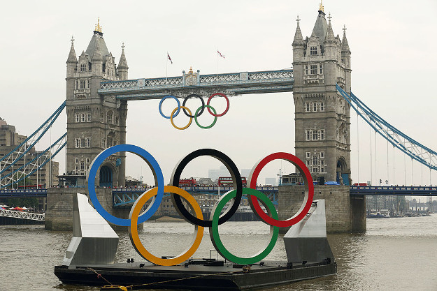 Giant Olympic rings are pictured mounted on a barge floating on the River Thames in front of Tower Bridge in London, July 27, 2012, just hours before the official opening ceremonies of the London 2012 Olympic Games.