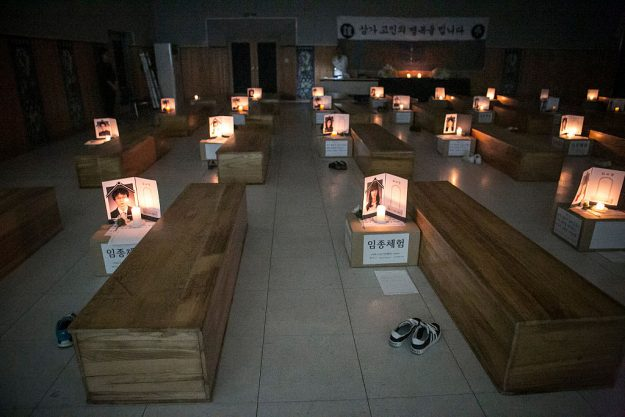 Participants think about their lives as they lie down in a coffin.