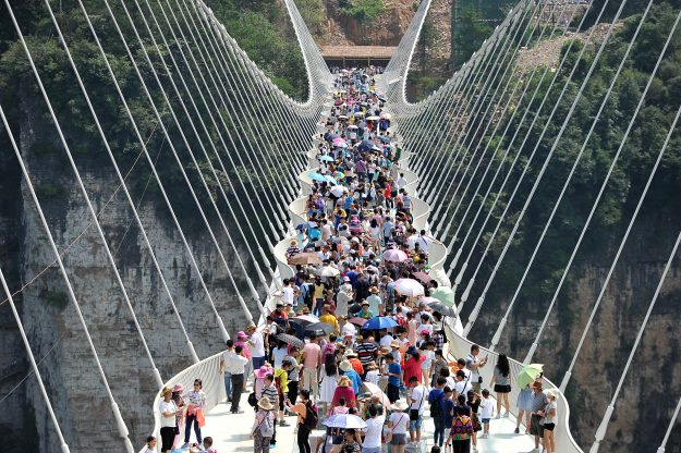 An aerial view of tourists visiting the glass-bottom bridge at Zhangjiajie Grand Canyon during the first trials last weekend.