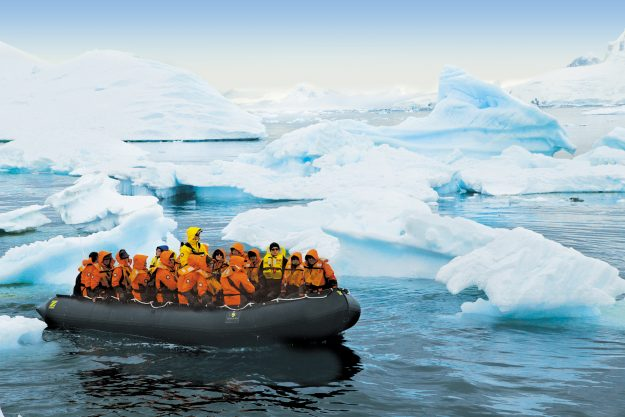 Passengers explore the Antarctic on board the Zodiac lander.