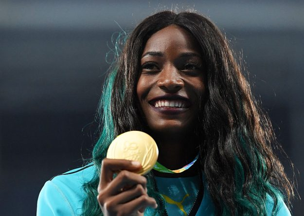 Gold medalist Shaunae Miller of the Bahamas with her medal for the Women's 400m Final