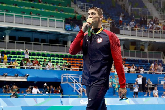 Michael Phelps takes gold at the Aquatic Stadium which was not filled to capacity.