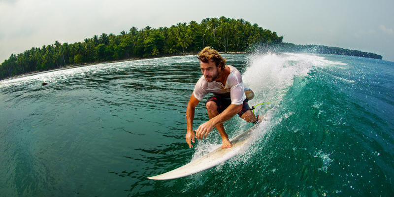 A young surfer rides a wave at the Mentawai Islands in Indonesia.