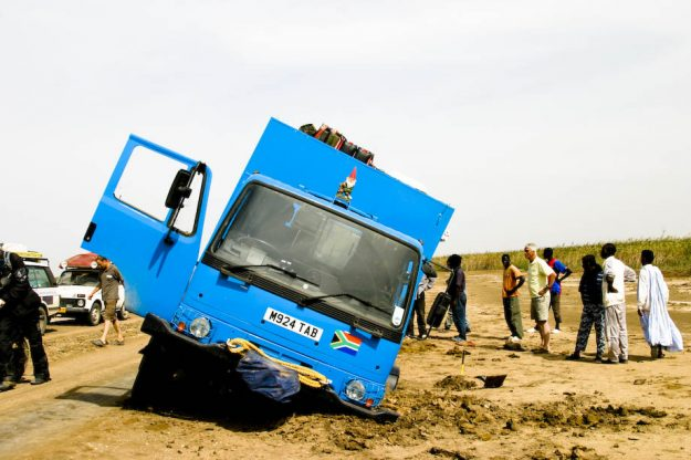The truck broke through the boggy clay marshland near Senegal and was dug out by members of the Amsterdam Dakar Rally.