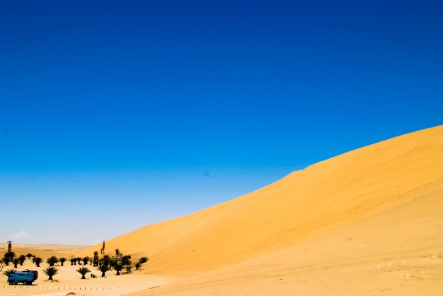 The 10-tonne van looks dwarfed by the giant sand dunes in Namibia.