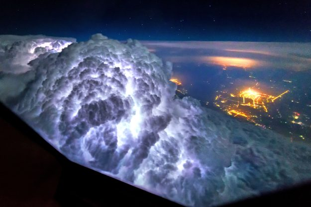 Thunderstorms light up the insides of cloud formations.