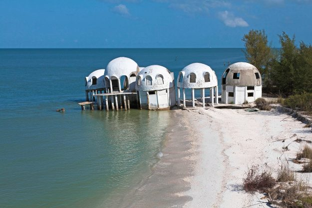 Cape Romano, USA. Built in the early 1980s, these solar- powered homes were occupied for ten years before 1992's Hurricane Andrew and 2005's Hurricane Wilma damaged the houses and tore away part of the coastline. Today, the houses can only be reached by boat.