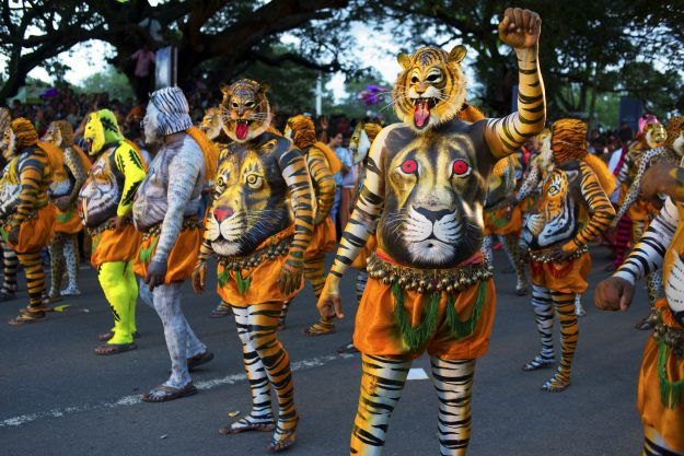 Crowds take to the street in Kerala, India for Pulikali, a traditional dance that sees men painting themselves as tigers.
