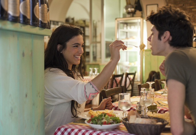 A couple dines in a restaurant in Italy.