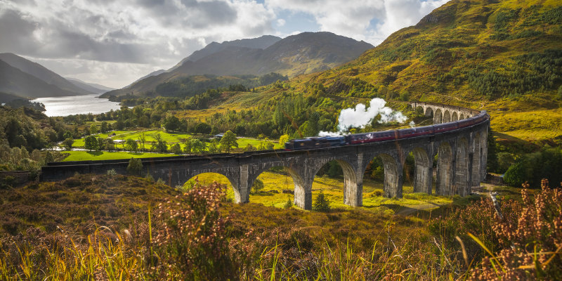 UK, Scotland, Highland, Loch Shiel, Glenfinnan, Glenfinnan Railway Viaduct, part of the West Highland Line, The Jacobite Steam Train.
