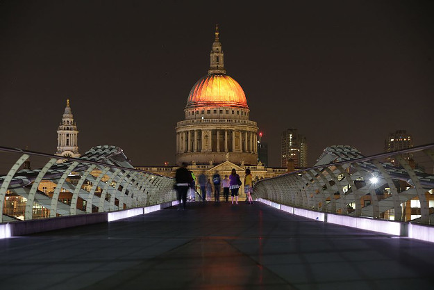 The dome of St Paul's Cathedral is lit up with a fiery projection during a rehearsal of artist Martin Firrell's 'Fires of London: Fires Ancient' ahead of the London's Burning festival.
