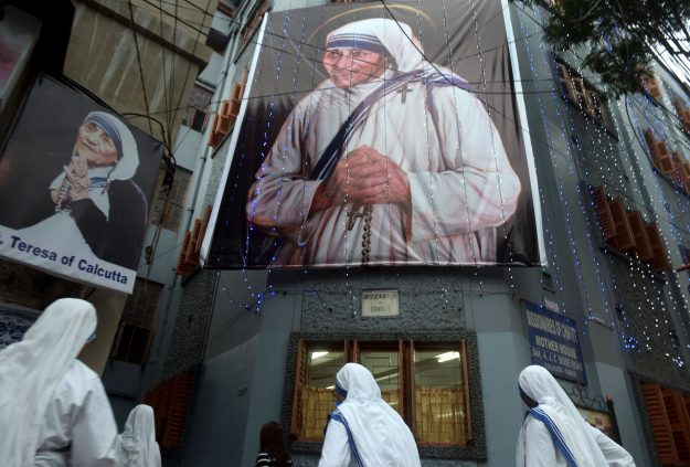 Roman Catholic nuns of the Missionaries of Charity order arrive for a service to commemorate the 19th death anniversary of Mother Teresa at the Missionaries of Charity house in Kolkata.