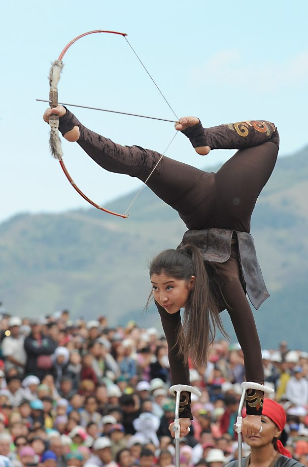 A girl in traditional dress perform and impressive display at the World Nomad Games.