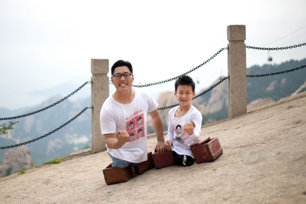 32-year old motivational speaker Chen Zhou and 11-year old Gao Zhiyu on the trail of Mount Lao.