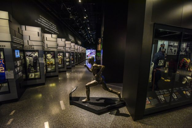 A statue of sprinter Jesse Owens stands in the sports galleries at the Smithsonian Institute's National Museum of African American History and Culture.