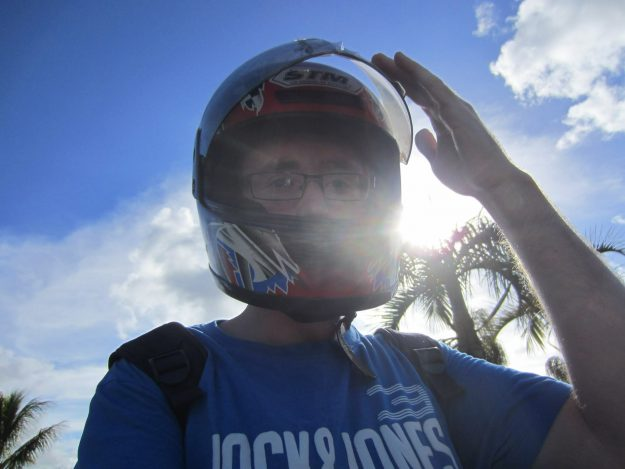 Hitch hiking in Mauritius and getting a lift on a motorbike.