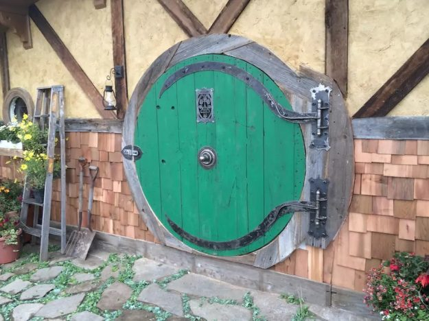 The house has the iconic round door from JRR Tolkien's The Hobbit and The Lord of the Rings .