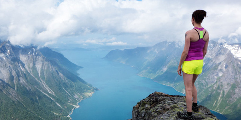 A photographer's girlfriend stands at the top of a mountain. BREATH-TAKING images show a female mountain climber standing perilously above the clouds. The collection of spectacular shots shows one photographer's girlfriend standing at 5,000-feet up whilst overlooking the beautiful Norwegian fjords. Other images show her perching on a ledge as though she is sitting on top of the world. Norwegian warehouse worker Johan Kistrand (33) walked for up to five hours to each location to capture the beautiful images. Accompanied by his girlfriend who also features in the shots, the locations were situated anywhere between six and eighteen miles apart.