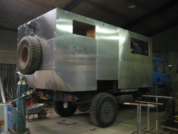 A newly added metal box on the ex-army truck.