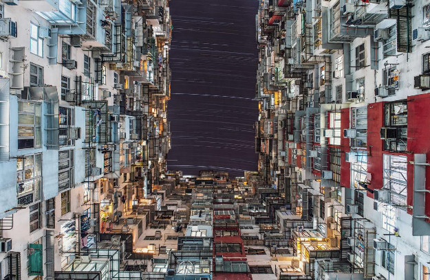 The 2016 winner for the People and Space category is 'City Lights' by Wing Ka Ho (Hong Kong) , taken at Quarry Bay, Hong Kong.