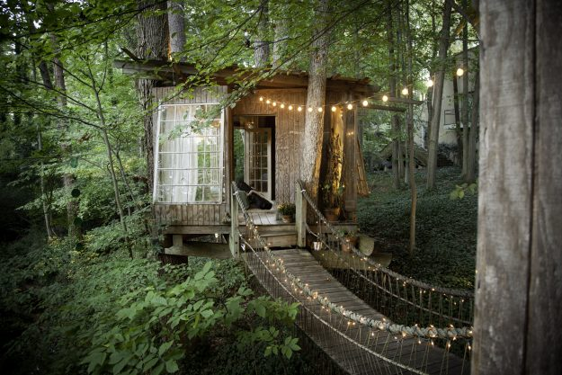 Three tree houses connected by rope bridges nestled deep in the Southern United States. Designed by Peter Bahouth.