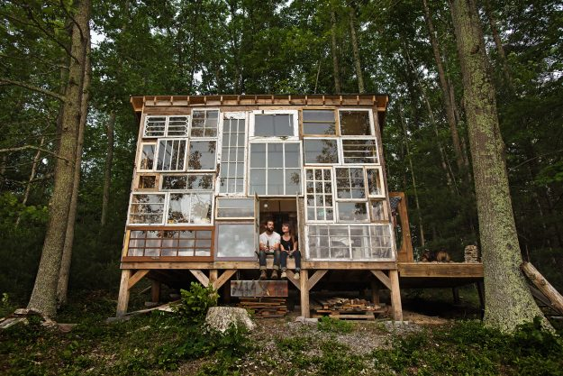An intimate shack with a wall of windows built by couple Lilah Horwitz and Nick Olson in West Virginia.