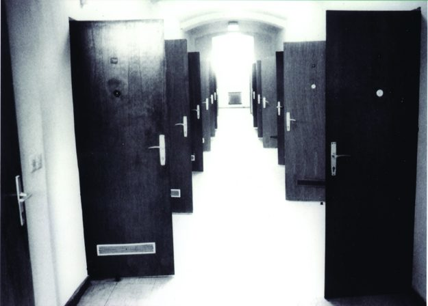 An archive picture of the hallway in the building when it was a prison.