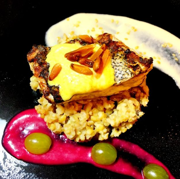 Fish and freekeh with a beetroot sauce and frozen sesame sauce