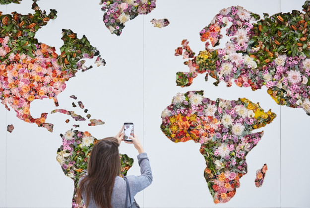 A giant floral map of the world is unveiled at Heathrow to celebrate the airport's new global fragrance report. The map is 11 ft. by 18ft and uses around 2,000 fresh flower stems and showcases the most popular scents by country en vogue right now, as well as celebrating the new season fragrances.