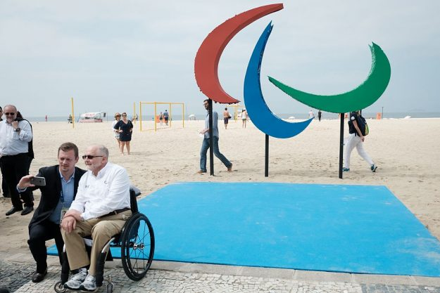 Philip Craven (R), President of the International Paralympic Committee, and Andrew Parsons, President of Brazilian Paralympic Committee, take pictures before the inauguration of the symbol of the Rio 2016 Paralympic Games at Copacabana Beach in Rio de Janeiro, Brazil, on September 2, 2016. The sculpture is made out of recycled materials collected at the beach and offers different textures and smells for the interaction with people.