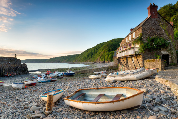 Boats in the harbour at Clovelly an historic fishing village on the Devon Heritage Coast.
