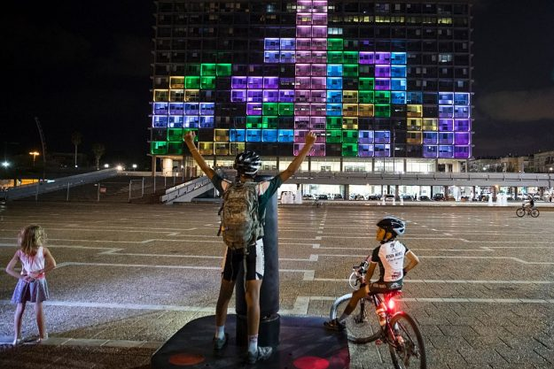 An Israeli cyclist plays against foreign visitors