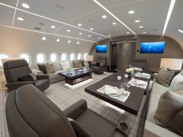 The lounge area of the 787 Jet is kitted out to suit business meetings and entertaining.