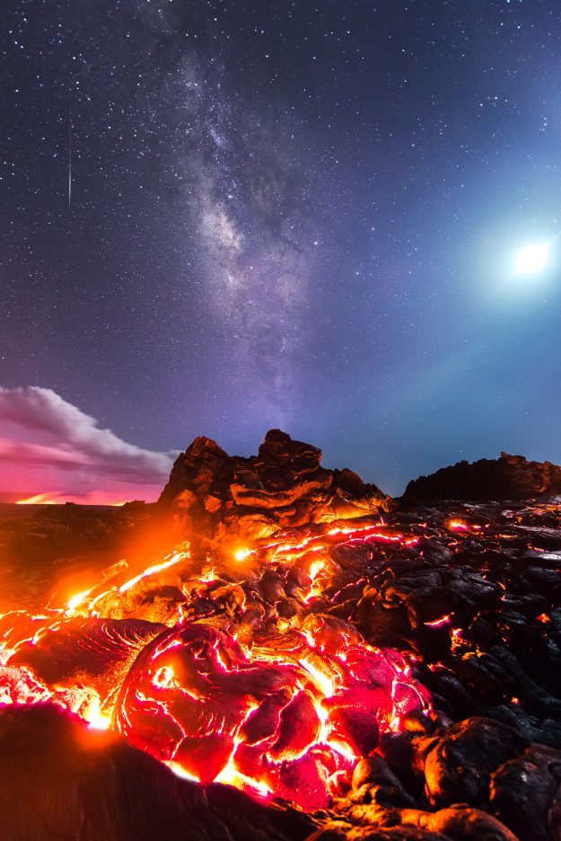 This stunning photograph shows lava flowing from the Kilauea Volcano with the Moon and the Milky Way overhead.