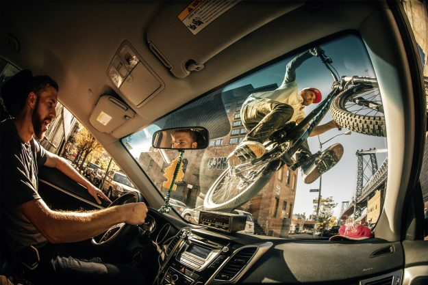 The winning shot in the New Creativity category depicts Aaron Chase riding a bike on a cab in Brooklyn, New York.