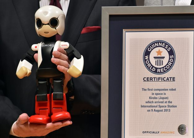 Kirobo receives a certificate from Guinness World Records for being the world's first astronaut robot.