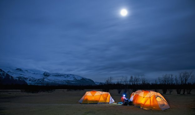 Sitting outside a tent at night in Skaftafell, Vatnajokull National park, Iceland, is very hygge. Image: Henn Photography/Getty Images